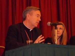 Bishop speaking on panel