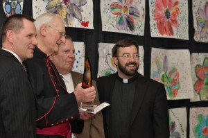 Pictured above (Left to Right): Alan Rock, Catholic Charities Executive Director, Monsignor Heslin, Brian Soland, Catholic Charities Retired Executive Director, and Rev. Andrew Ricci, Rector, Cathedral of Christ the King